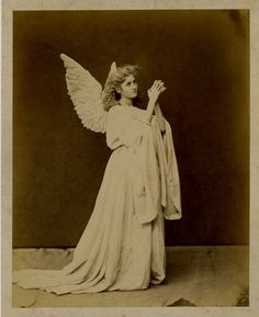 Actress in angel costume. 1870s
