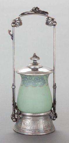 A MERIDEN BRITANNIA SILVER-PLATED PICKLE CASTOR WITH SATIN GLASS JAR Meriden Britannia Company, Meriden, Connecticut, circa 1890