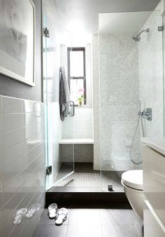 White bathroom with glass shower doors