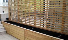 contemporary Iroko with planter