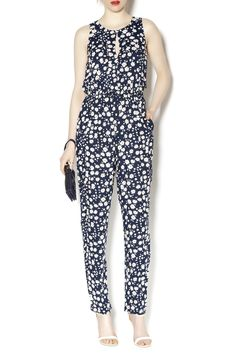 Sleeveless daisy print jumpsuit with front and back peekaboo slits and pockets