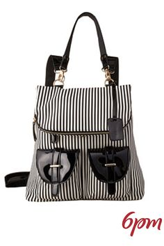The Tonia Striped Backpack with Pockets from Gabriella Rocha is a perfect bag for back to school or the lady on the go. With two different ways to carry it, both a removable handle and backpack straps, you are sure to love carrying it. The black and white design gives it a sophisticated vibe.