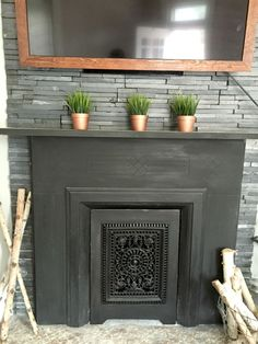 In our last post, we shared how we added fancy ledger stone to the corner chimney area of our living room (hint: spray paint was involved) and restored the orig… Frame Around Tv, Builder Grade Kitchen, Globe Decor, Bathroom Ceiling Light, Fireplace Mantels, Fireplaces, Reclaimed Wood Art, Framed Tv, Christmas Mom