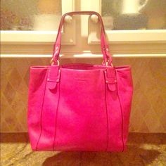 Kate Spade large pink leather tote EUC Beautiful pink bag that is in excellent used condition, only used a few times! There are a couple tiny barely visible dark marks on the back and then the corners have light signs of wear. The last picture shows the worst corner. Leopard print lining with one interior zip pocket and two interior flap pockets. Can be used as a diaper bag, work bag or school tote - holds a laptop and books perfectly! I got compliments on this every time I went out with it…