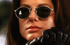 "Sandra Bullock en ""Demolition Man"" Sandra Bullock Speed, Sandra Bullock Hot, Sandro, Demolition Man, Round Sunglasses, Mens Sunglasses, Sylvester Stallone, James Movie, Bing Images"