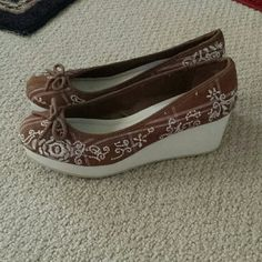 American Eagle Embroidered Wedges Only worn once/Nearly brand new! American eagle brown wedges with white embroidered detail. American Eagle Outfitters Shoes