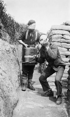 Here we see a two-man team from the 1st Cameronians using a Vermorel Spray, a device designed to help disperse poisoned gas in trenches. The device sprayed 'hypo solution', a mix of chemicals that included Sodium Hyposulphite, a chemical used in photographic processing. This chemical mix neutralised a number of the poisoned gasses used during the First World War