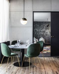 The jewel green Beetle Chairs in combination with the white marble GUBI Table set the perfect fine dining atmosphere. Photo via Dining Room Inspiration, Interior Inspiration, Inspiration Design, Room Chairs, Dining Chairs, Lounge Chairs, Dining Area, Office Chairs, Office Decor