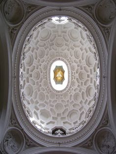 The magnificent ceiling of San Carlo alle Quattro Fontane by Borromini.