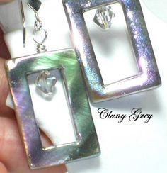 mother of pearl jewelry is a pair of rectangle earrings with crystals