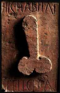 "The Roman word for phallus was fascinum. It was the ultimate symbol of power, luck, and fertility. A large penis symbolized everything positive. Shops and brothels hung images of them on their walls for good luck, accompanied by the words, ""Here lies happiness."" They believed that the male member was the source of life. Bas relief from Pompeii, Hic Habitat Felicitas"