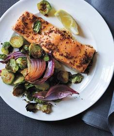 Maple-Glazed Salmon With Roasted Brussels Sprouts|Brush the fish with a mixture of maple syrup and whole-grain mustard before cooking to add sweetness, tang, and a little texture.