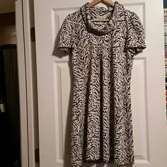 Calvin Klein Cowl Neck Dress sz 6 Beautiful, warm fabric Calvin Klein sz 6 Cowl neck dress, had a bit of flair when one, zips up the side, animal print design. Perfect condition can be worn all year round with the right accessories!  Smoke and pet free home  Please feel free to ask questions, or request additional photos  Don't forget to bundle for discounts! Calvin Klein Dresses Midi