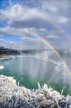 Rainbow over the Rainbow Bridge  Niagara Falls Ontario, Canada  by Ron Clifford