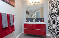 Give your bathroom extra flair with high-gloss red GODMORGON bath cabinet. Photo courtesy of theshare-space.com