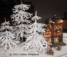 Winter Trees for Miniature Scenes Made From Simple Cut Paper Snowflakes. would make a great centerpiece for table