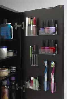 9. Stick-on storage. These kind of remind me of organizers for your high school locker, but I love the effect! Small things can easily be knocked around inside a shallow vanity mirror, but StickOnPods utilizes the door side to keep lipsticks and toothbrushes safe and secure.