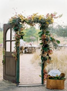 A transition for entering outdoor event. This was obviously timed for the fall, but the composition would work with any greens. Maybe for outlining the door of the barn? With magnolia leaves, rosemary, and other thick greenery?