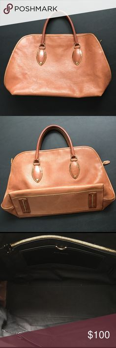"""Tan Leather Satchel Elie Tahari tan leather satchel. Discoloration on handles due to normal use as seen in pictures. Otherwise in great condition.  Approximate measurements as follows. Length 15"""" , width 6"""" , height from bottom to top zipper 11.5"""" Elie Tahari Bags Satchels"""