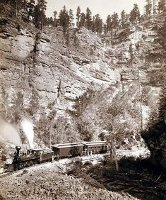 Train steaming through the Black Hills, in Elk Canyon on the Black Hills and Fr. P R.R. Taken in 1890 by John C. H. Grabill.