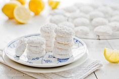 Hot from the oven, these melt-in-your mouth cookies are tossed in a mixture of crystallized lemon and powdered sugar for the most incredible intense lemon flavor ever!