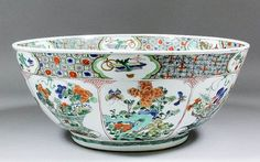 A Chinese porcelain bowl enamelled in the 'Famille