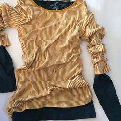 H&M L.O.G.G. Shirts Two long sleeve knit shirts (t-shirt fabric). One yellow and white striped and one dark teal. In perfect condition. Teal shirt is XS so it more easily fits under the yellow shirt. Yellow is S. H&M Tops