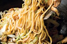 """During Chinese New Year, long noodles are eaten in all corners of China. """"Longevity noodles,"""" also presented at birthday celebrations, are never cut or broken by the cook, and if they can be eaten without biting through the strands, it's considered even more auspicious. (Photo: Steven Mark Needham for The New York Times)"""