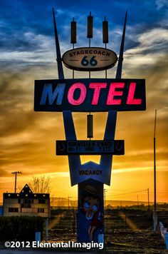 Sunsetting behind the neon sign at the Stagecoach 66 Motel, Seligman Arizona, west of Flagstaff on old Route 66. Definitelya place that revels in the history and legends of the old Route.