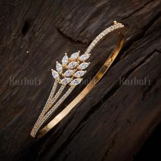 Designer zircon kada studded with zircon stones, plated with gold polish and made of copper alloy! Gold Rings Jewelry, Jewelry Design Earrings, Gold Earrings Designs, Gold Jewelry Simple, Bracelet Designs, Jewellery Designs, Gold Ring Designs, Gold Bangles Design, Stylish Jewelry