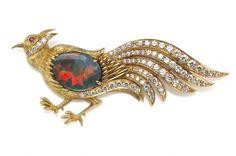 An opal, diamond and eighteen karat gold bird brooch, mounted by Harry Winston