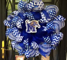 University of Memphis is having an awesome football season! This gorgeous royal blue and white wreath will help you show your Tiger pride for our