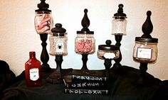 Dollar store candle sticks, and glass jars primed and painted black and put together with E6000! Soo cute