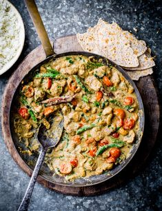 Make your own Sri Lankan curry powder and combine with coconut milk and toasted cashews to spice up chicken thighs in this impressive curry. Scoop up with warm roti for a comforting midweek meal