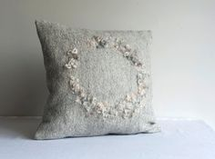 Grey Decorative Pillow, Wool Felt Cushion, Pure Wool Pillowcase, Housewarming Gift Felted pillow cover made from pure merino wool. Other natural fibres create a texture in the middle. The back is made from heavier weight grey cotton. Part of my Nest collection - cushion covers created around the idea of nest as a cosy, always welcoming and warm place. This is a sample piece. Please allow 10 working days for production.  The listing is for cover only. Zipper or envelope closure. Please, write…