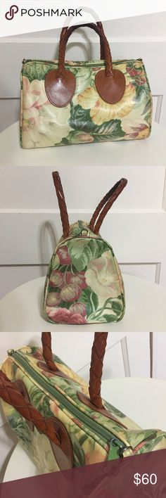 """•Nordic House• Vintage Floral Doctor Handbag This vintage doctor style bag is in EUC and features a pastel floral orchard pattern throughout. The exterior is made of coated cotton, braided leather handles (slight darkening from use), green zip closure, & green cotton lining interior. There is an interior zip pocket as well. Set includes matching cosmetic bag & checkbook cover. Handbag measures 11"""" W x 19"""" H x 6"""" D, 6"""" drop handle. Cosmetic bag measures 6"""" W x 4.5"""" H x 2"""" D. Please see pics…"""