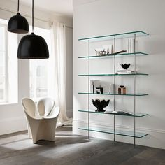 The glass shelves provide a neutral, yet effective wall design Glass Bookcase, Glass Wall Shelves, Glass Shelves Kitchen, Wall Mounted Shelves, Kitchen Cabinets, Modern Bookshelf, Bookshelf Design, Glass Furniture, Living Room Furniture