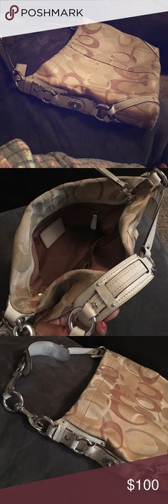 Large signature Coach Bag Heavy hardware with white leather trimming.  The khaki color has tan and beige large C's. The details along the sides makes this bag extra special.  It's 14 inches wide, 10 inches deep and only 2 inches thick on the sides. Coach Bags Shoulder Bags