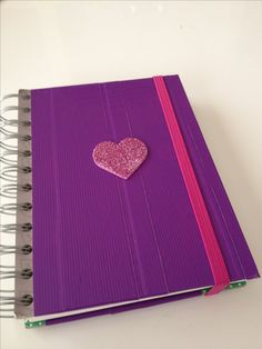 DIY doc mcstuffins big book of boo boos- purple duct tape, pink foam glitter sticker, upcycled chipboard spiral note book = the doc is in !