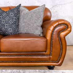 It is all about the details. The metallic studded detailing of our Isilo Leather Sofa Suite is guaranteed to add a touch of class to any living room. Leather Furniture, Leather Sofa, Lakeside Mall, 2 Seater Sofa, Leather Material, Wingback Chair, Upholstery, Metallic, Touch