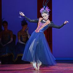 Larrissa Lezhnina as Stepmother Hortensia in Christopher Wheeldon's Cinderella. Dutch National Ballet, London, July 2015, © Dave Morgan. Imperious stepmother Hortensia (Larissa Lezhnina) hits the bottle, with delicious timing. When she rips off Cinderella's mask in a drunken rage, the girl flees, belatedly aware of a deadline, leaving her gold pointe shoe behind.
