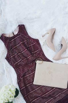 We've got a sugar high after feasting our eyes on the Keepsake Sweet Nothing Burgundy Lace Midi Dress! Stunning burgundy lace tops nude knit across a fitted bodice with a rounded neckline and princess seams. A curving waistline transitions into a figure-flaunting midi skirt with a sheer hem and back kick pleat.  #lovelulus