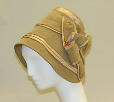 It's odd how 1920s this 1840s bonnet looks without its wide ribbon tie at the chin. I like this one for Clare given its subtlety and tailored quality.