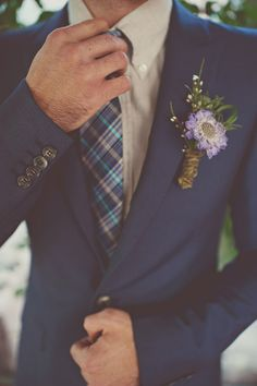 Love this look -- dapper navy with a gingham tie looks SO good! | http://www.weddingpartyapp.com/blog/2014/09/30/fall-groom-and-groomsmen-style-ideas/