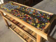 This Awesome Bottle Cap Bar Cart was handmade and is part of our Beetle Kill Collection! Tons of character with this piece! The guitar top