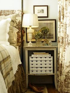 Traditional bedroom with brown toile and plaid fabrics... Charming...