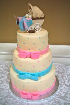 3-Tiered Baby Shower Cake with Baby Carriage, Pink & Blue Ribbons