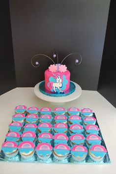 Unicorn Cupcakes and personalized cake.