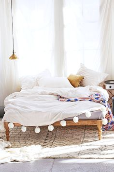 Cozy, bohemian bedroom with pom pom duvet