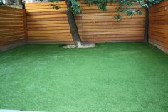 Backyard in Park Slope, Brooklyn with artificial turf + horizontal fencing... I wish I went this route.